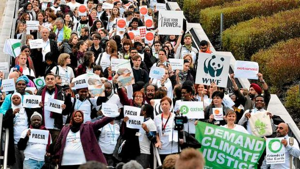 Members of NGOs walk out of the UN Climate Change Conference in Warsaw, claiming the talks are 'on track to deliver ...
