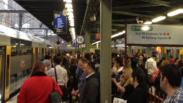 Commuters wait for more than 30 minutes for a Western Line train to move out from platform 18 at Central.