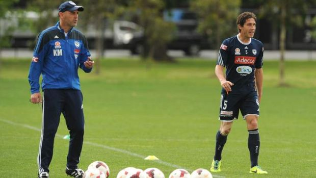 In charge: Kevin Muscat and skipper Mark Milligan at Melbourne Victory training on Friday. The team faces Adelaide in a ...