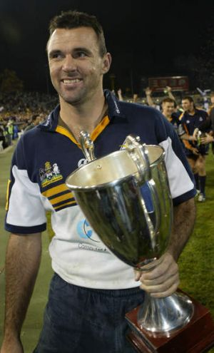 Brumbies great Joe Roff with the Super 12 trophy in 2004.