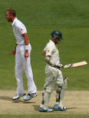 Contrasting fortunes: England's Stuart Broad celebrates the dismissal of Australia's Chris Rogers.
