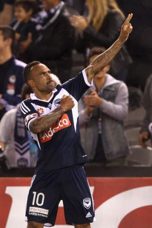 Archie Thompson celebrates his goal.