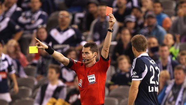 Farewell: Victory's Adrian Leijer is shown a second yellow card.