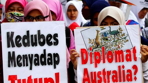 Tension continues: Protesters rally in front of the Australian Embassy building in Indonesia.