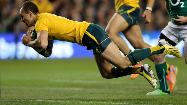 Bodies in motion: Quade Cooper finishes off an impressive attacking raid by the Wallabies.