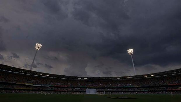 Storm clouds gather above the light towers during the fourth day's play at the Gabba.