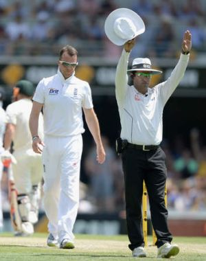 Cannon fodder: England's frontline spinner Graeme Swann gets belted for six by Michael Clarke.