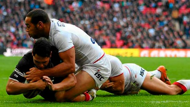Roger Tuivasa-Sheck of New Zealand scores his side's opening try.