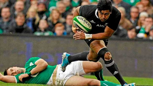 Julian Savea pounces on a kick by Aaron Cruden to score the opening try for the All Blacks.