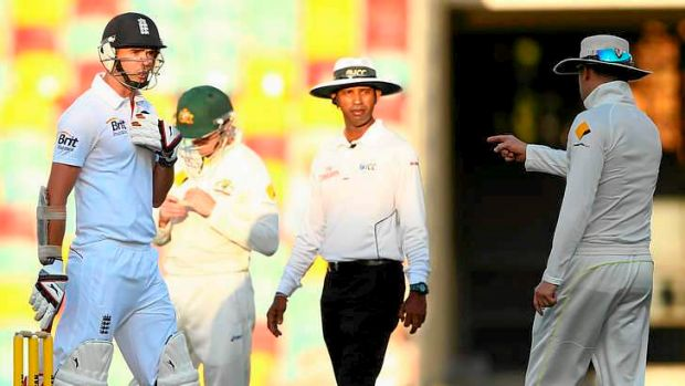 Exchange of views: James Anderson of England and Australian captain Michael Clarke.