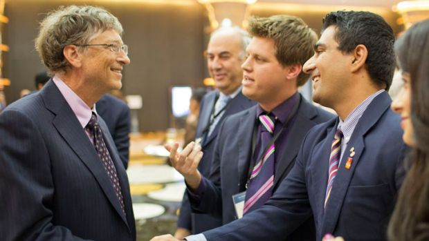Mr Sheldrick introducing his friend, Young Australian of the Year 2013 Akram Azimi, to Bill Gates.