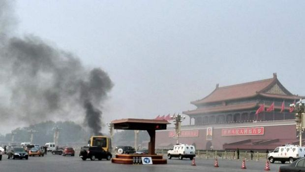 Smoke rises into the air in Tiananmen Square after a four-wheel-drive burst into flames in what Chinese authorities say ...