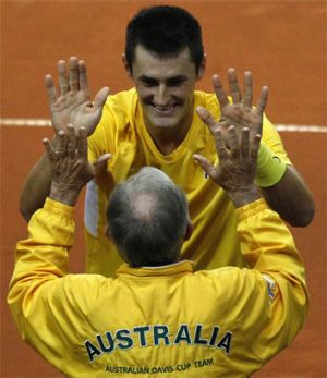 Hands up: Tony Roche with Bernard Tomic in the Davis Cup tie in Poland in September.