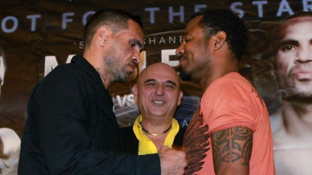 Talk is cheap: Anthony Mundine and Shane Mosley enter the ring Wednesday night.