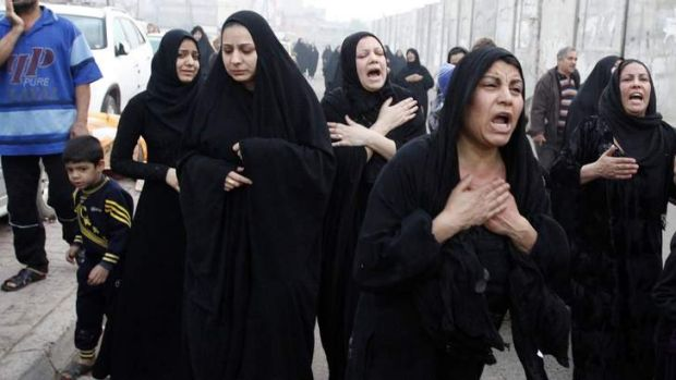Anger and despair: Shi'ite women mourn during the funeral of a victim, who was killed in bomb attacks outside a cafe in ...