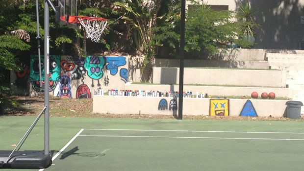 Spray paint cans can be clearly seen at the tennis courts of the QT Hotel, after Justin Bieber wound down after his ...
