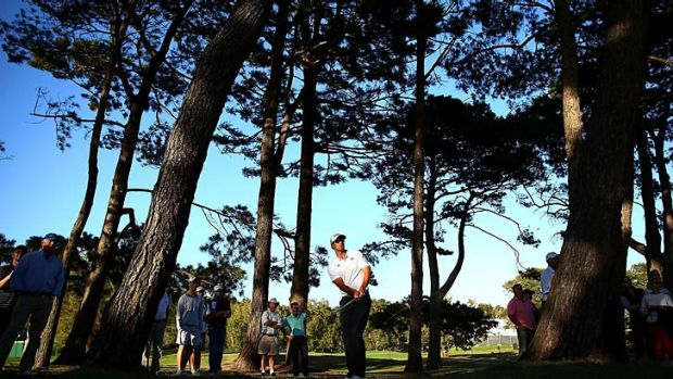 Following through: Adam Scott plays the 18th hole at Royal Sydney.