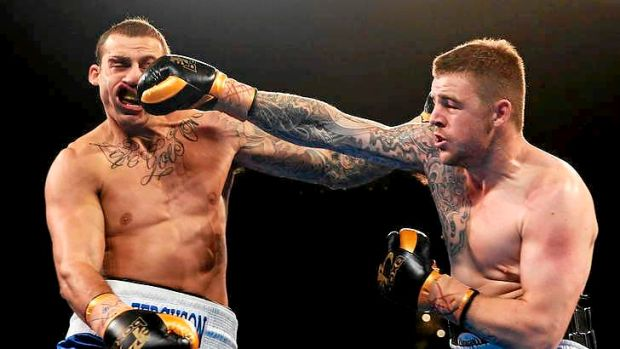 Bam: Rookie heavyweight and former footballer Luke Turner lands a heavy right on NRL bad boy turned Mundine protege ...