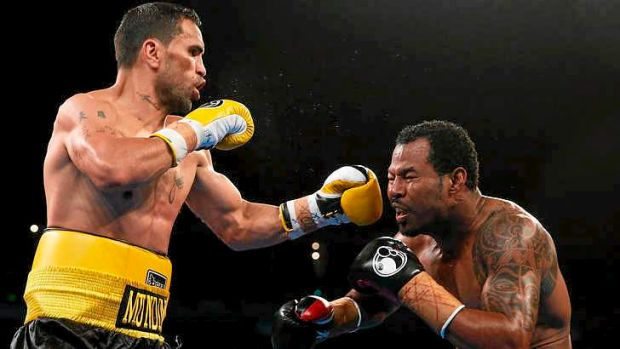 TKO: Anthony Mundine lands a left on Shane Mosley.