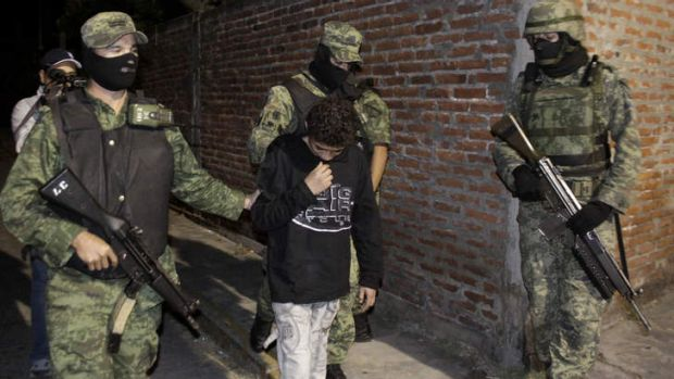 "Child killer ... Mexican soldiers with Edgar ""El Ponchis"" Jimenez Lugo in the city of Cuernavaca, Mexico after his ..."