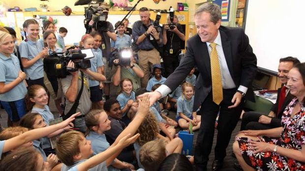 Opposition Leader Bill Shorten meets with students from Ainslie Primary School in Canberra on Thursday.