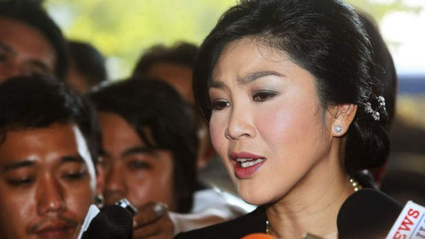 Yingluck Shinawatra, Thailand's prime minister, speaks to members of the media as she arrives at Parliament House in Bangkok.