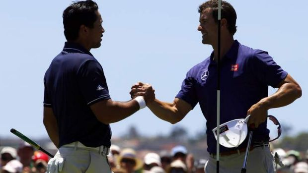 Jason Day shakes hands with Adam Scott after they finished their first rounds.