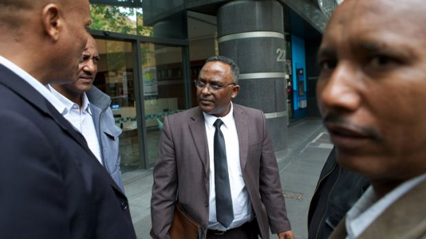 Victim Michael Atakelt's father, Getachew Seyoum (centre), believes the investigation into his son's death was mishandled.