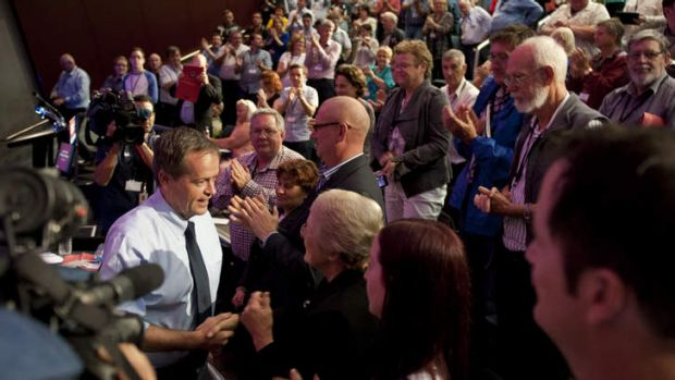 Federal opposition leader Bill Shorten greets Labor party faithful after speaking at the Queensland Labor Party state ...