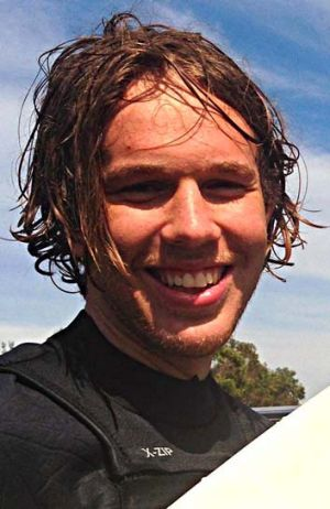 Zac Young, 19, was surfing with three friends when he was bitten on the legs by a shark.