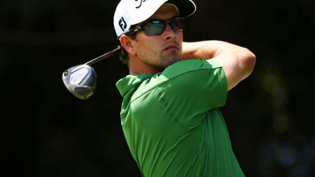 Adam Scott of Australia plays his tee shot on the fourth hole during day three.