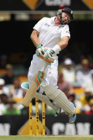 Ian Bell of England evades a short pitched ball from Mitchell Johnson at the Gabba.