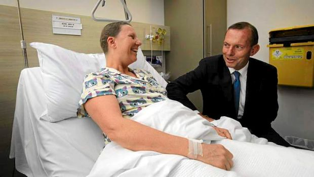 New order: Tony Abbott, with breast cancer patient Hilary King, announces funding for chemotherapy infusion drugs at The ...
