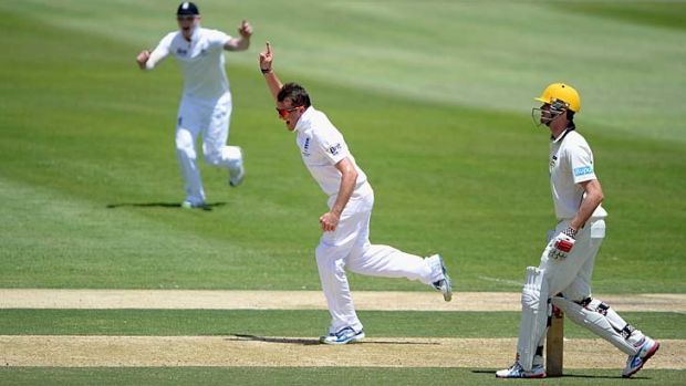 Graeme Swann celebrates after dismissing Jake Doran.