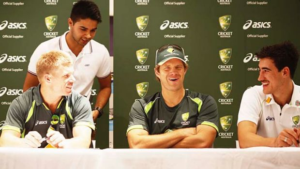 David Warner, Shane Watson and Mitchell Starc signing merchandise at an outlet on Saturday.
