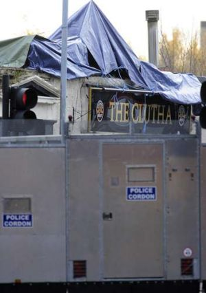 Clutha Vaults pub: a police cordon has been erected around the site of the crash.