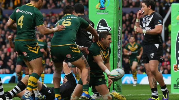 Billy Slater scores the opening try for Australia.