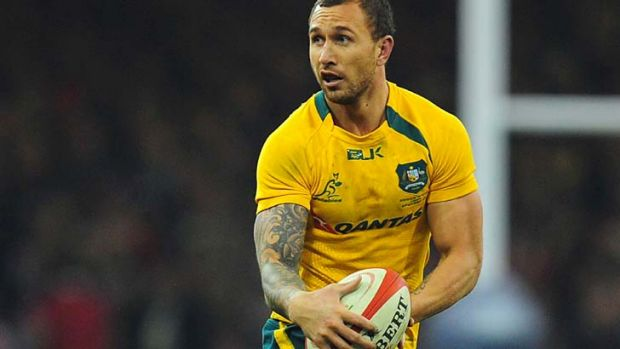 Man of the match: Quade Cooper makes a break for the Wallabies.