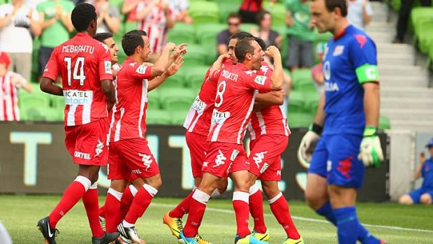 David Williams of the Heart celebrates with teammates after he converted a penalty.