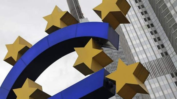 A structure showing the Euro currency sign is seen in front of the European Central Bank.