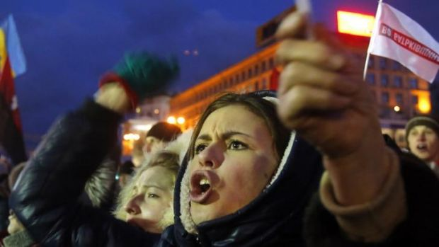Protesters shout and wave flags during a rally at the central Independence Square in Kiev, Ukraine.