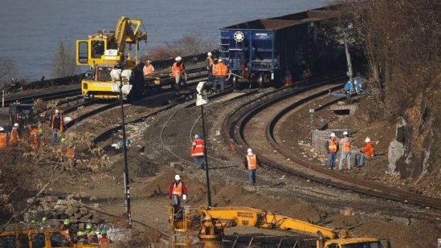 Workers busy on the tracks of the Metro-North train derailment in the Bronx borough of New York.
