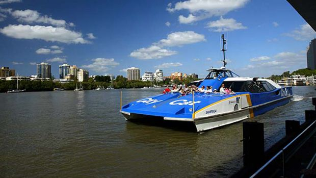 A CityCat docks on the Brisbane River.