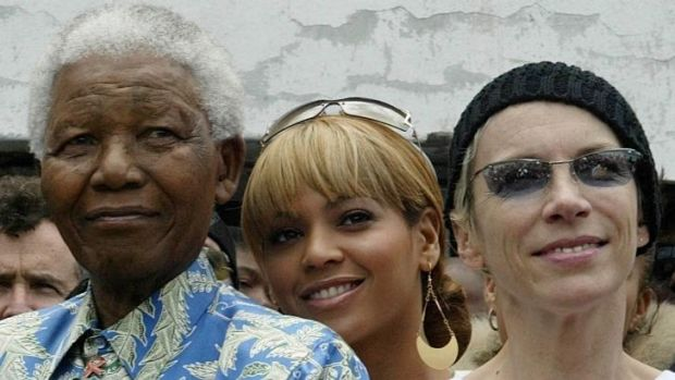 Nelson Mandela, from left, with  US singer Beyonce Knowles and British singer Annie Lennox on Robben Island in Cape Town.