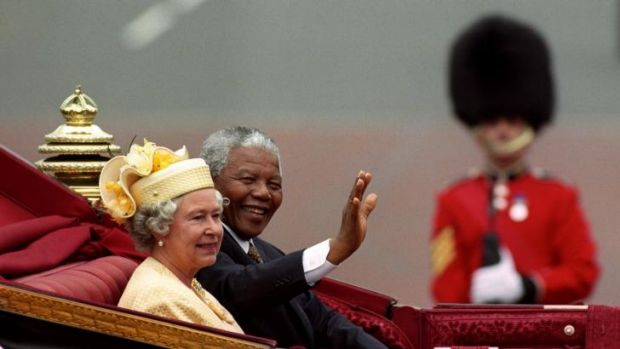 Nelson Mandela with Britain's Queen Elizabeth II riding in a carriage along the Mall, London, on the first full day of ...