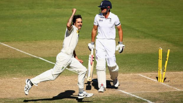 Prize scalp: Mitchell Johnson pumps his fist after dismissing Alastair Cook.