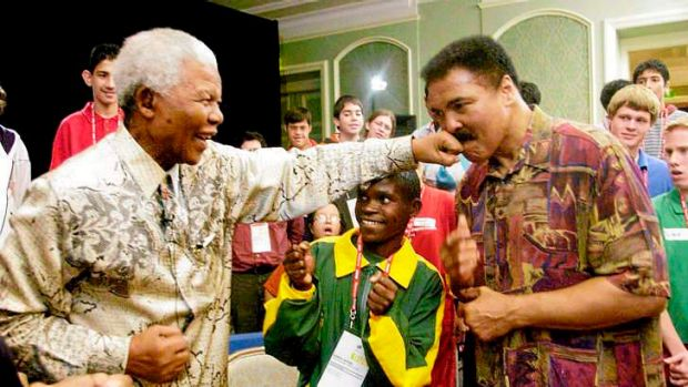 "Mandela lands a ""straight left"" to the chin of Muhammad Ali in 2003."