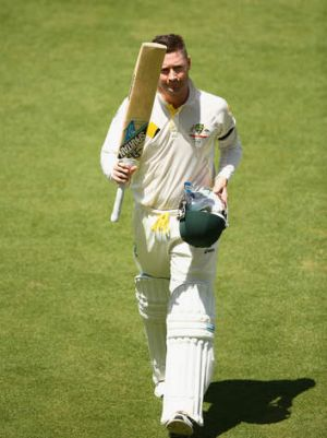 Michael Clarke of Australia acknowledges the crowd as he walks off the ground.