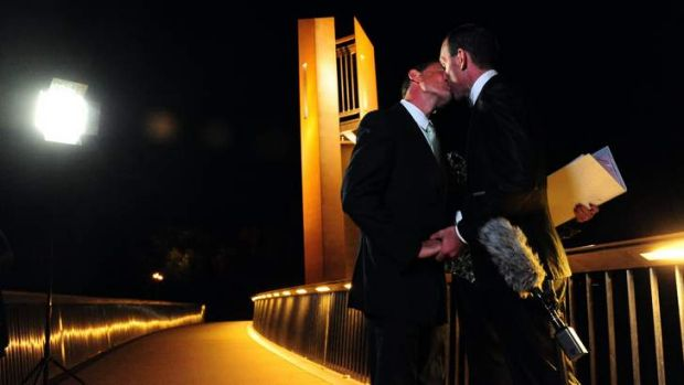 Alan Wright, left, and Joel Player celebrate becoming Australia's first same-sex married couple, at 12.01am on December ...