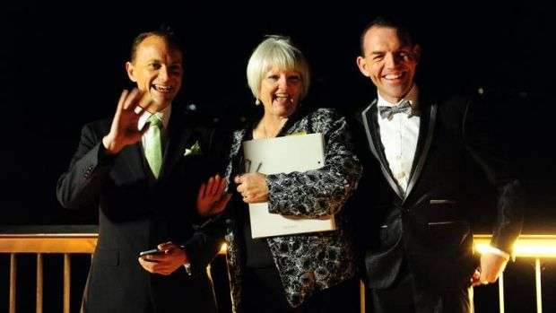 ACT celebrant Sharyn Gunn, centre, officiates over Australia's first Australian legal same sex marriage between Alan ...